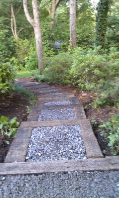 Walkway with stone and railroad ties.
