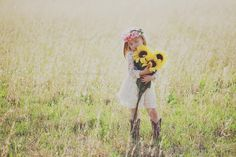 little girl in field sunflowers photography child