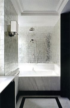 Gorgeous small bathroom ~ designer take on the shower over the bath