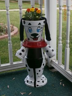 Flower pot dog with flowers :)                                                                                                                                                                                 More
