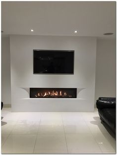 Tulp balanced flue gas fire with the superb undercover shaped fascia set in a false chimney breast with fully inset TV. Living Room Decor Fireplace, Fireplace Tv Wall, Linear Fireplace, Modern Fireplace, Living Room Tv, Fireplace Design, Fireplace Ideas, Wall Tv, Fireplace Inserts