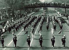 1960 University of Minnesota Homecoming with the Marching Band leading the way.
