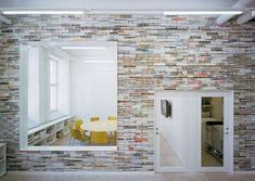 """Magazine Wallpaper! """"A graphic design company in Stockholm has come up with a pretty ingenious way to reuse their old glossy magazines. The office has entire walls plastered in old magazines, with only the spines displayed.""""    Designed by Elding Oscarson http://www.trendhunter.com/trends/magazine-wallpaper"""