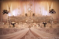 Vintage wedding decor at Whistle Bear. Wow! Love the hanging sheer fabric, so romantic