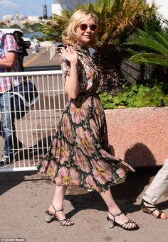 In her florals: Kirsten Dunst looked gorgeous in vintage florals as she turned out for duties at Cannes Film Festival on Tuesday