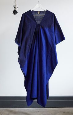 """Thicker Ikat cotton caftan in a deep blue with a bright ikat degrade front. Color: Navy with electric blue - — Length 49"""" - — Width 40"""" - — custom design handloomed ikat sari - — One size - — Free dom"""