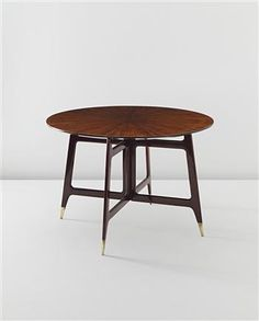 View Rare dining table by Gio Ponti sold at Design on 26 April 2012 London.