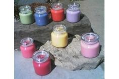 In order to make strongly scented soy candles, you must use essential oils that are 100 percent pure. The strength of the oil you use will also determine how strong your candle will smell. Adding too much fragrance oil may prevent the candle from burning properly, and it can cause the oil to seep back out of the candle once it hardens. Once you...
