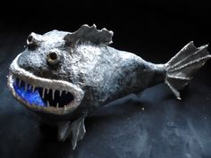 "Paper Mache fish.  My happiest ""art memory"" was a giant funky goldfish I made out of papier-mâché as a kid."