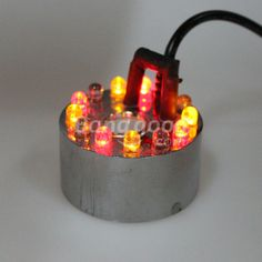 Wholesale 12 LED Colorful Fogger Light Water Fountain Pond Mist Machine--This to go with a fan and fake logs in my DIY electric fireplace