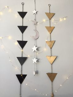 Prismatic Wall Hanging Decor. Im gonna diy this with spray painted cardboard pieces and string