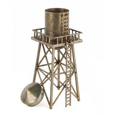 Bring a rustic touch of industrial intrigue to your indoor decor with this  water tower sculpture 04bb6038166d