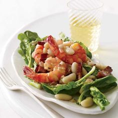 Warm Spinach Salad with Cannellini Beans and Shrimp | The combination of sweet shrimp and meaty little cannellini beans here transforms a simple warm spinach salad.