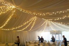 Fairy light splay canopy in a marquee