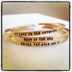"""I loved hand-stamping my favorite Ralph Waldo Emerson quote onto these cuffs. """"Live in the sunshine, swim the sea, drink the wild air."""""""