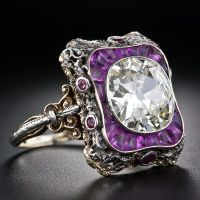 Antique Diamond Ring Early 20th Century: 4.23 carat antique cushion-cut center diamond.