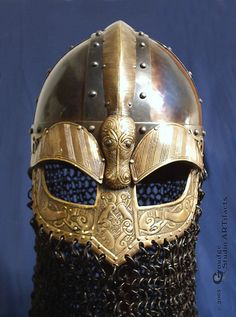 Norse Valsgarde style helm    Heat-blued Steel & Brass. Decoration all chased by hand (not etched), based on a variety of norse sources.