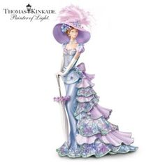"""This collectible Thomas Kinkade Victorian lady figurine showcases the artistic fusion that occurs when Mr. Kinkade's """"Victorian Garden"""" artwork is inspired by Louis Comfort Tiffany-style stained-glass designs! A floral stained-glass pattern enhances Emily's vintage style gown, while Swarovski® crystals and simulated jewels adorn her picture hat, hair, sash and parasol. Stroll down memory lane with this limited-edition porcelain lady figurine, available exclusively from The Bradford Editions…"""