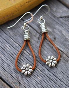 Cowgirl Daisy Leather Earrings Put on your cowboy boots and stick a flower in your hair to match these cool, country chic earrings that feature [. Jewelry Trends, Boho Jewelry, Jewelry Crafts, Beaded Jewelry, Jewelery, Jewelry Accessories, Fashion Jewelry, Cowgirl Jewelry, Silver Jewelry