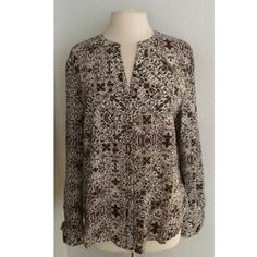 """FLASH SALE! Sanctuary button down Sanctuary button down blouse. Brand new with tags. Size L. 100% polyester. Measures 26"""" long with a 40"""" bust. The front has a button closure and there are buttons on the cuffs of the sleeves as well. Brown/ beige color combination with light hints of purple. No trades. Poshmark only. I am very open to fair offers! Sanctuary Tops Button Down Shirts"""