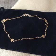 14 Kt. Gold Anklet  Has hearts all around it Jewelry