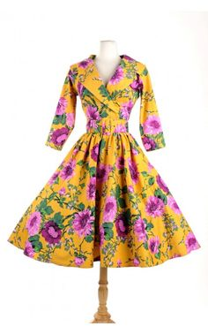 Birdie Dress in Mustard and Purple Floral with Three-Quarter Sleeves from Pinup Girl Clothing.   1950s pinup dress