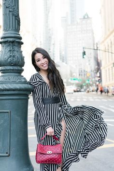All smiles because winter is officially over in NYC! Embracing these black and white stripes with an added belt for a cinched waist!
