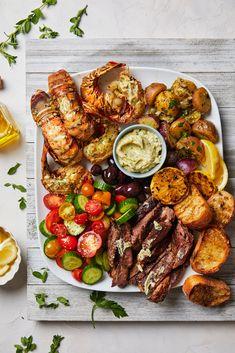 Steak And Lobster Dinner, Steak And Seafood, Grilled Seafood, Seafood Dinner, Grilled Lobster Recipes, Greek Potato Salads, Greek Potatoes, Grilled Steak Seasoning, Seafood Platter