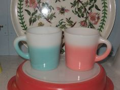 Hazel Atlas mugs.  HA milk glass mugs - I love pink & turquoise together.