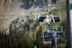 Colorado Mountain Wedding. Bride and Groom on a chair lift. Arapahoe Basin.