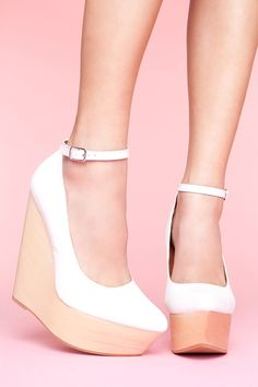 I'd definitely pair these platform wedges with the skirt.  The tights and these shoes together will be an sharp contrast but they will tie in together with the bright neon skirt as all three pieces that have a retro throwback and the neutral colours of the tights and shoes won't overpower the skirt.  #nastygal #minkpink