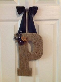 Fast shipping & turn over time. Personalized letters wreath hanger with customized handcrafted felt flowers, and rosettes. on Etsy, $21.99