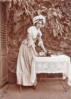 History in Photos: Cabinet Cards.   Maid serving tea in the garden
