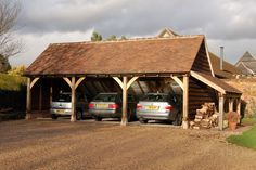 Three bay small frame garage with log store. Andrew Page Oak Ltd, South Oxfordshire. Quality Oak framed Garages, Garden Rooms, Gazebos, and Orangeries in Green Oak. Bespoke furniture and joinery.