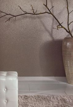 Mica is an exclusive textured wall covering which gives an illusion of metallic gravel on the wall. It looks great on a feature wall particularly on a chinmey breast around a contemporary fire. its exremely easy to hang and remarkably soft to the touch.