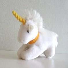 1980s clip-on mini unicorn.  We all had these, and the koala bears.