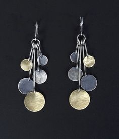 hammered disk drop earrings by lisa crowder; want to try these w/ aluminum can discs - mk