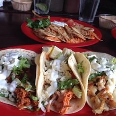 (left to right) Chorizo Taco , Tinga Chicken Taco, and Grilled Chicken Taco.Chicken Quesadilla (In the back) .