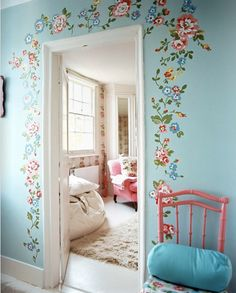 Love the the romantic whimsical look of the flowers around the door