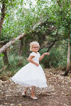 """Lisa was great help with quick responses. She also helped me customize the dress and added the sleeves with no extra charge! Great quality fabric and sewing. My daughter looked perfect for her special day and she loved to twirl in her princess dress! "" ---- Princessly.com Customer, Shelley McBride (Feb 27, 2017)"