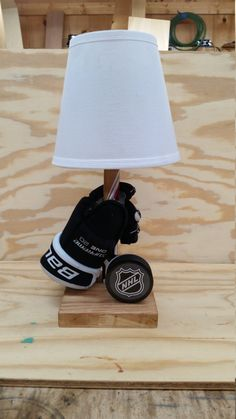 Customizable Hockey Lamp with glove, stick and puck. Any NHL team puck can be used. Any personal puck can also be used if provided by buyer. Boys Hockey Room, Hockey Mom, Hockey Girls, Hockey Girlfriend, Hockey Stuff, Hockey Man Cave, Soccer Room, Girls Golf, Hockey Crafts