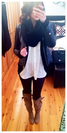 Winter outfit - black outfit with brown boots, layered tops, and an infinity scarf