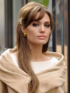 angelina jolie traditionally a minimalist when it comes to her long locks debuted side-swept bangs & a more golden tone