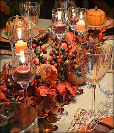 Pretty Fall Centerpiece using glass candle cups, a fall garland, faux pumpkins and acrylic fall colors table scatter - Dining Delight Thanksgiving Table Settings, Thanksgiving Centerpieces, Holiday Tables, Thanksgiving Wedding, Thanksgiving Pictures, Fall Table Settings, Christmas Tables, Candle Cups, Glass Candle
