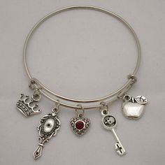 Once Upon a Time Evil Queen Regina in Storybrooke Crown Skull Apple... ($14) ❤ liked on Polyvore featuring jewelry, bracelets, charm jewelry, adjustable bangle bracelet, bangle charm bracelet, skull bangle and expandable charm bangle