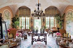 The winter garden of Valentino Garavani's asian-inspired château near Paris. The French doors open to the rear terrace and topiary garden.