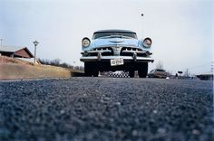 Blue car on suburban street, Memphis, 1970 - William Eggleston
