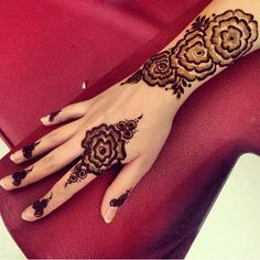 Roses in henna- these are very simular to the design on my veil...  It would be so pretty to kind of recreate the designs on my dress and veil. Ill get a close up photo of the appliques.