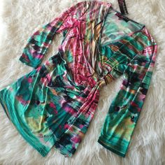 ARUBA BLUES.  TODAY ONLY SALE!!! Gorgeous and super soft !   V-neck faux wrap top.  Has amazing colors of blues greens pinks yellow black white and aqua. Size large.  NWT Peck & Peck Tops