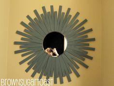 Greetings and Salutations. :) DIY Sunburst mirror made from mirror and paint sticks.